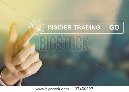 business hand clicking insider trading button on search toolbar with vintage style effect
