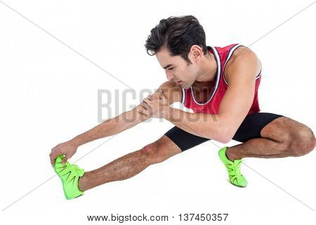 Male athlete stretching his hamstring on white background
