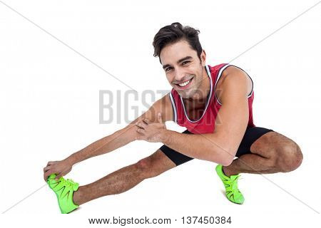 Portrait of male athlete stretching his hamstring on white background