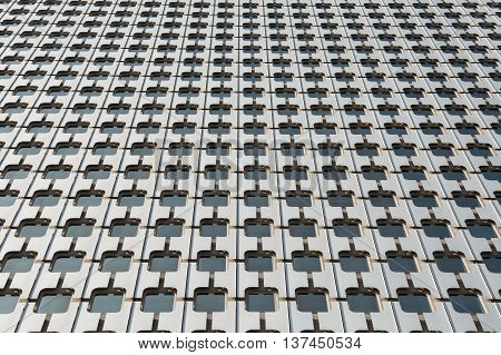 Pattern of the facade of a modern office building from steel and glass
