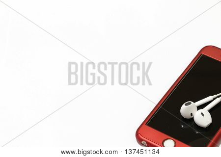 Smart Phone With Earphones on the white background