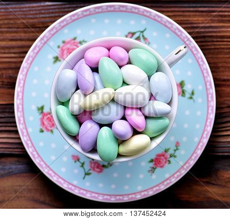 small colorful candies with almond inside, food