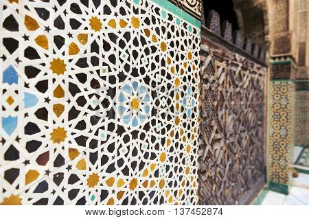 Detail of a wall ornamented with tiles in the Madrasa Bou Inania, in Fez, Morocco