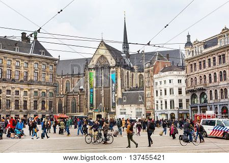 Amsterdam, Netherlands - March 31, 2016: Dam square, historical center of the city in Amsterdam, Holland