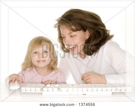Daughter Showing Mom Something On Computer Laughing And Having Fun