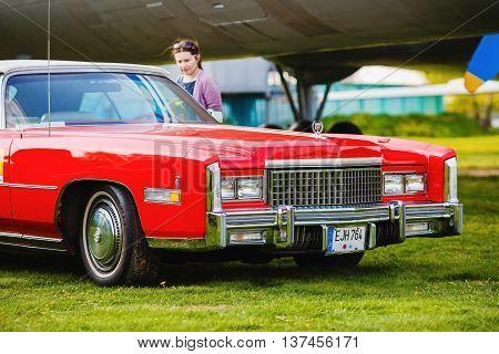 MINSK BELARUS - MAY 07 2016: Close-up photo of the red Cadillac Eldorado 1976 model year. Vintage retro car. Selective focus.