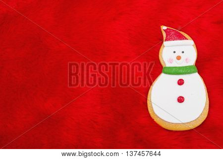 Red Plush Fur and Gingerbread Snowman Christmas Background with copy space for your message