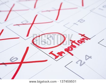 Close up handwriting word important with red ink on calendar desk