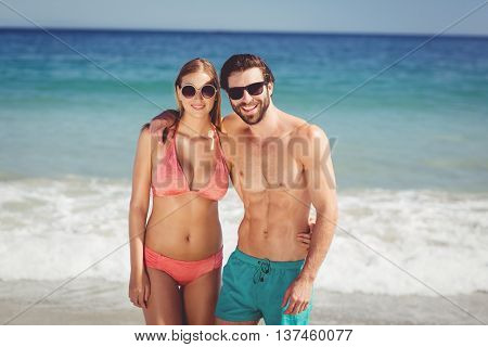 Portrait of happy young couple embracing each other on beach