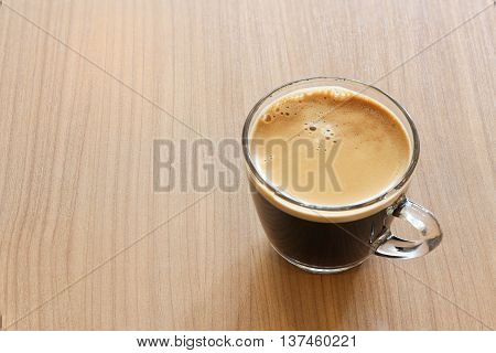 Black coffee on the wooden table Brown.