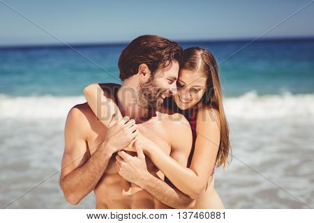 Romantic young couple embracing each other on beach
