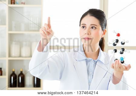 Asian Female Scientist Doing Research On Touch Screen
