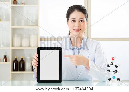 Asian Female Chemist Showing Blank Notepad To Research For Future Chemical Formula