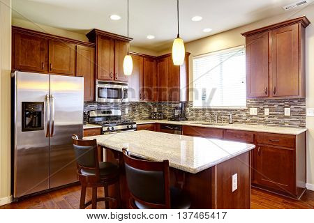 Kitchen Mahogany Storage Combination With Steel Kitchen Appliances And Back Splash Trim