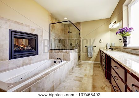 Master Bathroom In Modern House With Fireplace And Tile Floor