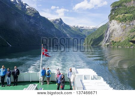 GERANGERFJORD, NORWAY - JUNE 29: Tourists on board the cruise ship admire spectacular views of the fjord on June 29, 2016 in Geirangerfjord, Norway. Geirangerfjord is UNESCO heritage site.