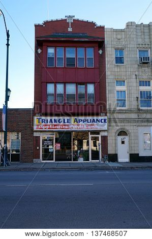 JOLIET, ILLINOIS / UNITED STATES - NOVEMBER 1, 2015: One may one's appliances repaired or serviced by Triangle Appliance in downtown Joliet.