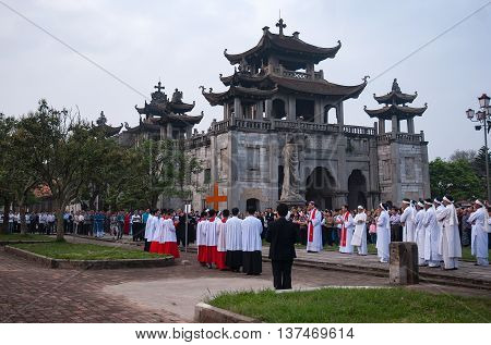 Ninh Binh, Vietnam, July 3, 2016 people participated in the consecration ceremony, on Sunday, in Phat Diem stone church, Ninh Binh Province, Vietnam