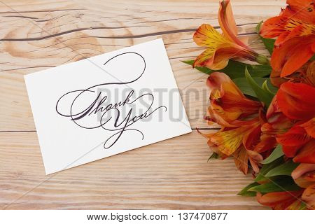 Thank You Message Some lilies on weathered wood with Thank You Card and copy space for your message