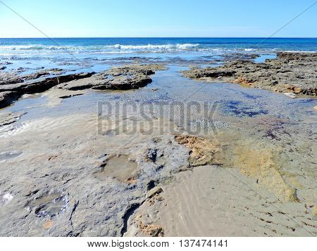 tide, sea scene with low tide and blue sky