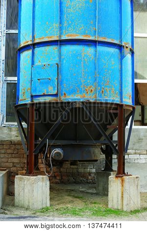 Old big blue tank on the factory