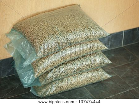 Cellophane bags with solid wooden pellets on the floor