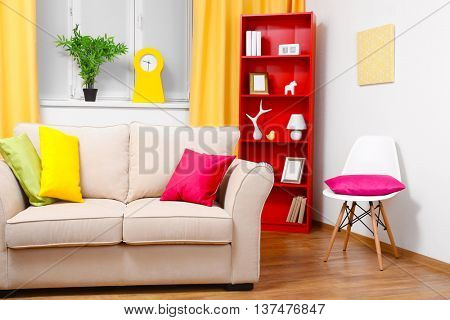 Modern interior design. Living room with sofa and bookcase
