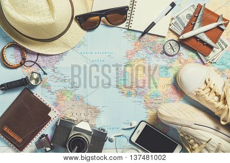 poster of Overhead view of Traveler's accessories Essential items of traveler Travel concept background