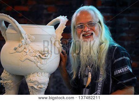 HA NOI, VIET NAM, April 16, 2016 older artists (unnamed), traditional villages and fine art ceramics, Bat Trang, a suburb of Ha Noi