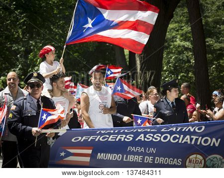 NEW YORK - JUNE 12 2016: Members of the National Latino Officers Association march in the 59th annual National Puerto Rican Day Parade on 5th Avenue in New York City on June 12 2016.