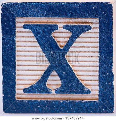Letter X old wooden block that is distressed