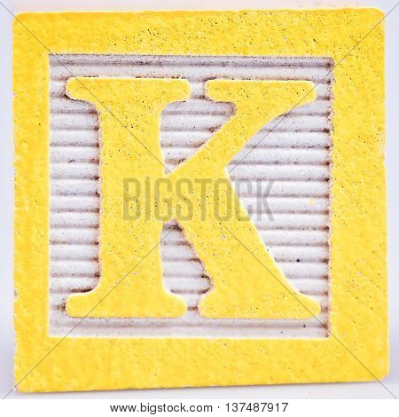 Letter K old wooden block that is distressed