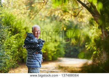 Active senior with inline skates in the nature