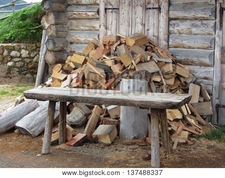 Pile of firewood next to hut cabin in mountain alps . Alpe di Siusi South Tyrol - Italy