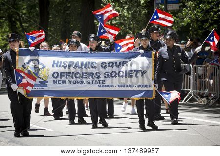 NEW YORK - JUNE 12 2016: Members of the Hispanic Court Officers Society march in the 59th annual National Puerto Rican Day Parade on 5th Avenue in New York City on June 12 2016.