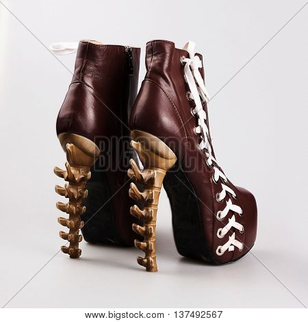 Fashionable women's boots in a grey background