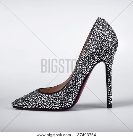 women's shoes inlaid with crystals over grey