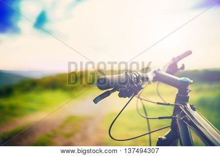 Mountain Bike Handle Bar At Sunset On Mountain Trail. Details Of Sport Activities