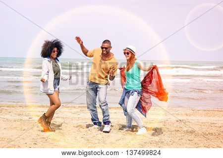 Multiracial happy friends dancing together at beach party on summer day - Cheerful multicultural young students having fun by the ocean - Concept of teenage joyful moment inside safer future sphere