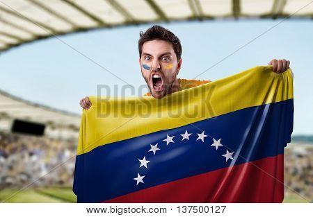 Fan holding the flag of Venezuela