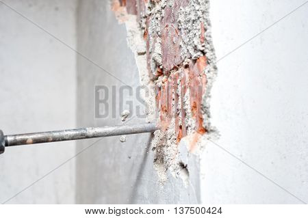 Close-up Of Jackhammer Distroying An Inside Wall In Construction