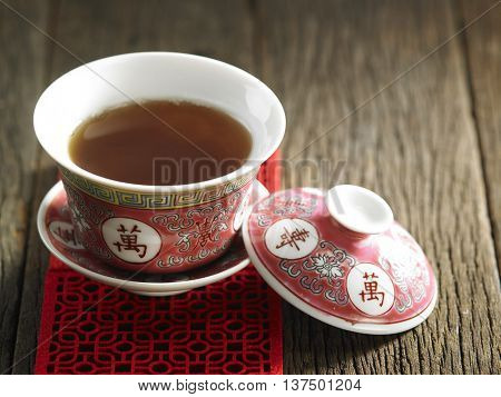 chinese tea cup with cover on the wooden background