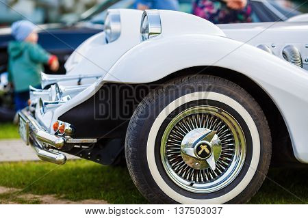 MINSK BELARUS - MAY 07 2016: Close-up of white Mitsuoka Le-Seyde. Vintage car. Shallow depth of field. Selective focus on the car's headlight.