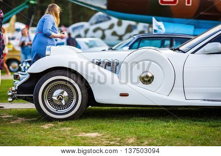 MINSK BELARUS - MAY 07 2016: Close-up of white Mitsuoka Le-Seyde. Vintage auto. Hood and the front wheel of the car. Side view. Selective focus.