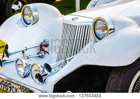 MINSK BELARUS - MAY 07 2016: Close-up of white Mitsuoka Le-Seyde. Vintage car. Selective focus on the headlight.