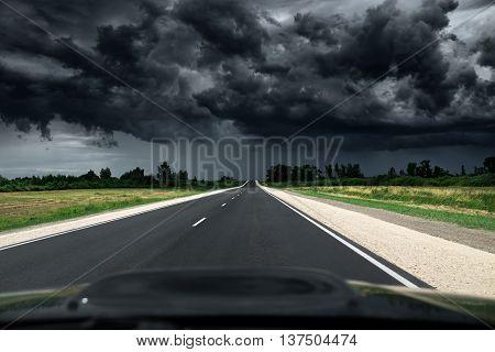 Empty Asphalt Road. Way To Thunder Storm