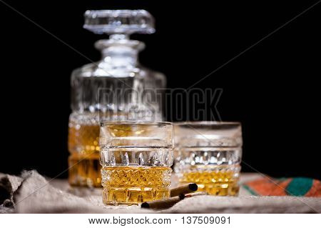 Whiskey And Scotch Drinks On Wood With Bar Bottle On Background