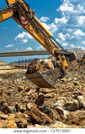 Professional Worker Moving Excavator Scoop While Loading Dumper
