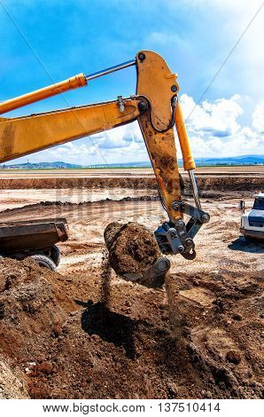 Industrial Construction Site With Working Excavator That Loads S