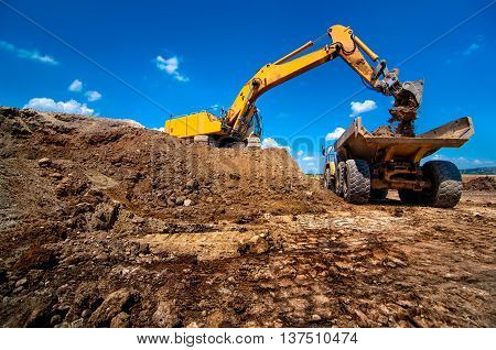 Industrial Excavator Loading Soil Material From Highway Construc